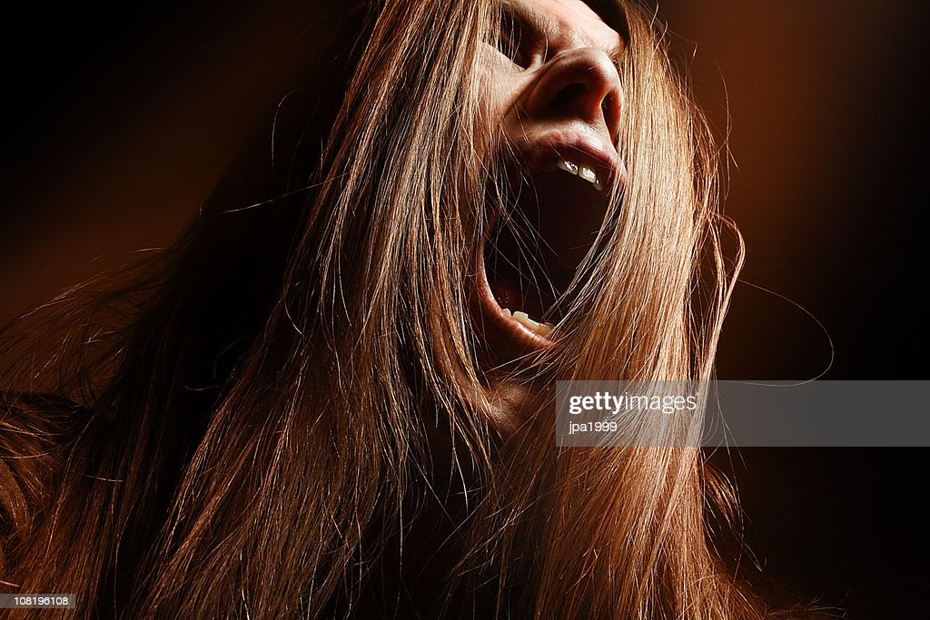 Man with Long Hair Yelling : Stock Photo
