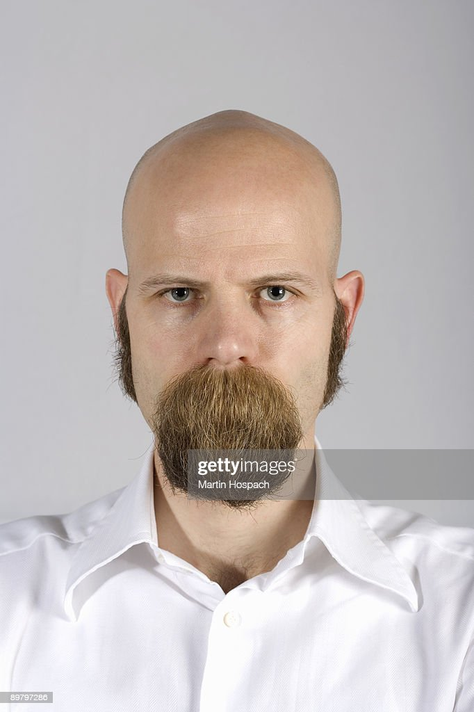 A man with long mustache hair covering his mouth : Stock-Foto
