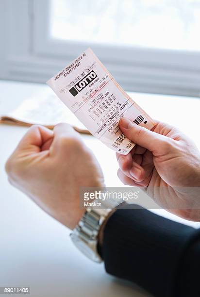 Man with lottery ticket