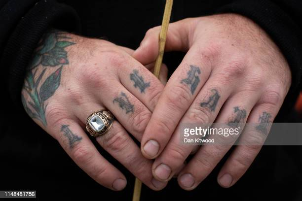 Man with 'Love and Hate' tattoos on his knuckles holds a whip during the annual Appleby Horse Fair on June 07, 2019 in Appleby-in-Westmorland,...