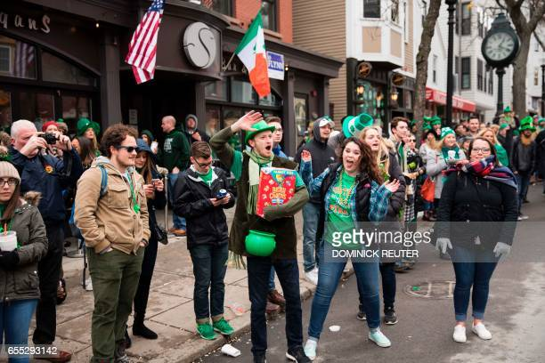 A man with Lucky Charms breakfast cereal waves at the annual St Patrick's Day parade in South Boston Massachusetts on March 19 2017 / AFP PHOTO /...