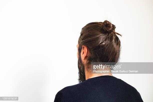 a man with man bun - beard stock pictures, royalty-free photos & images