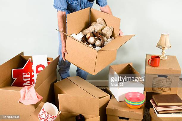 Man with many packed boxes for moving day.