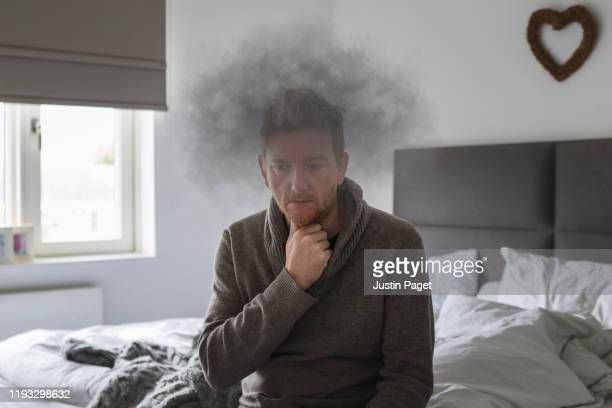 man with mental health issues - brain fog - brain  stock pictures, royalty-free photos & images