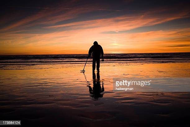 man with metal detector - metal detector stock photos and pictures