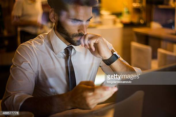 Man with mobile phone in coffee shop