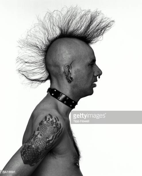 man with mohawk, profile (b&w) - piercing stock pictures, royalty-free photos & images