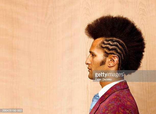 Man with mohican style haircut and braiding, profile, close-up