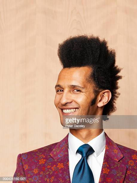 Man with mohican style haircut, smiling, portrait, close-up