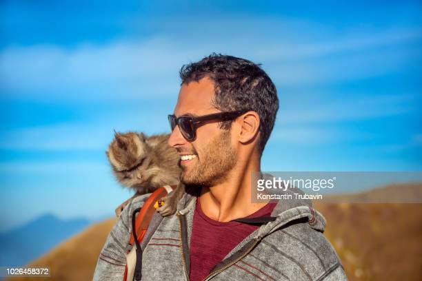 man with monkey on shoulder, mount batur, bali, indonesia - monkey man stock pictures, royalty-free photos & images