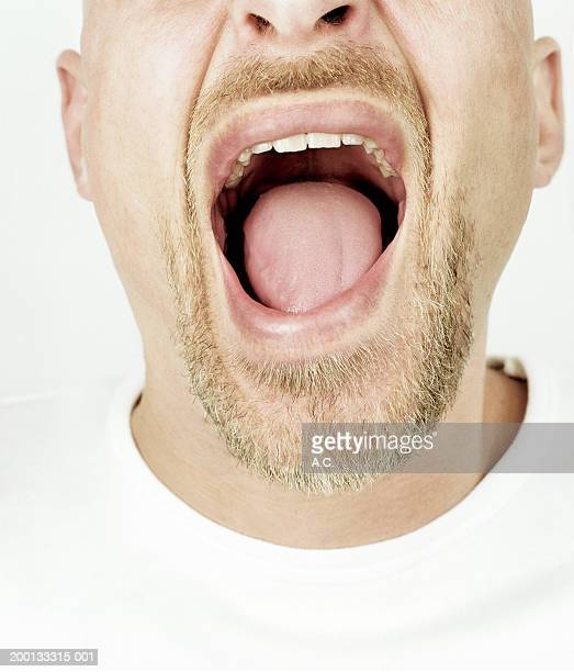 Man with mouth wide open, close-up of mouth