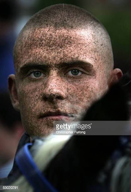 A man with mud spatter on his face is seen after riding his horse at the Appleby Horse June 4 2005 in ApplebyinWestmorland England Appleby Horse Fair...