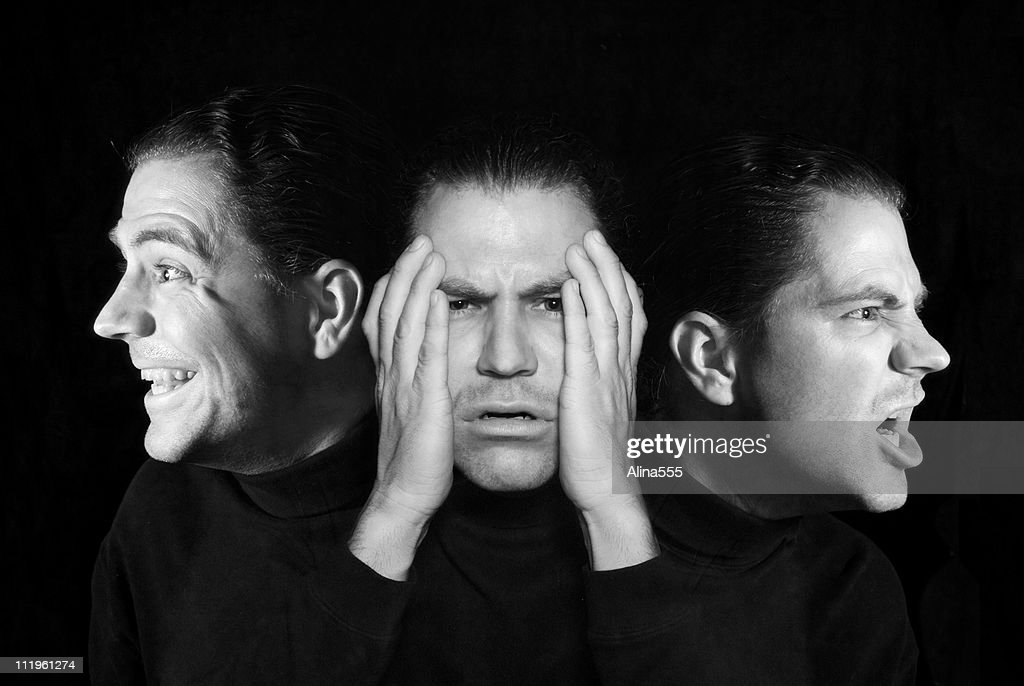 Man with multiple personalities : Stock Photo