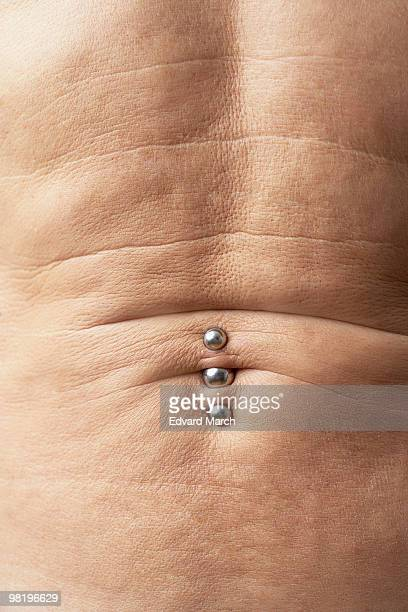 Man with navel rings