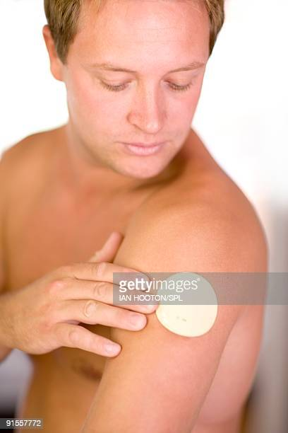Man with nicotine patch on arm
