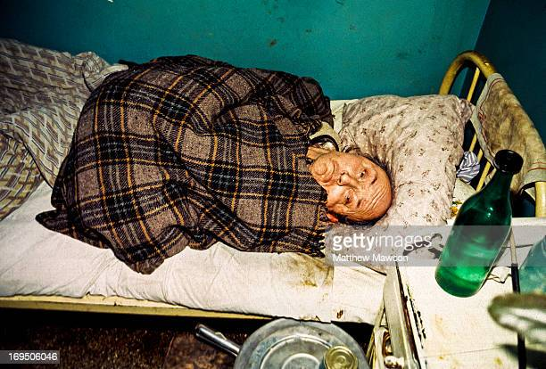 CONTENT] A man with no legs lies in a dirty bed in a hospital outside the town of Ciutelec Bihor County Romania This image was taken soon after the...
