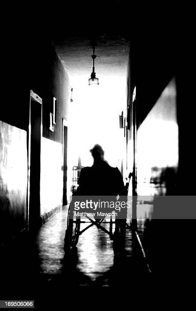 CONTENT] A man with no legs sits in a wheelchair in the corridor of a retirement home and hospital for the elderly outside Ciutelec in Bihor County...