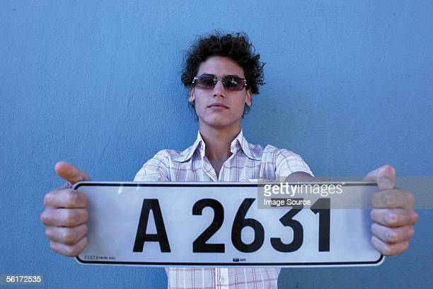 Man with number plate