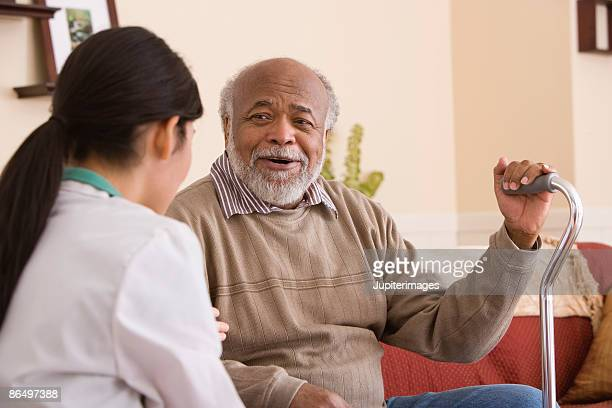man with nurse - walking cane stock photos and pictures
