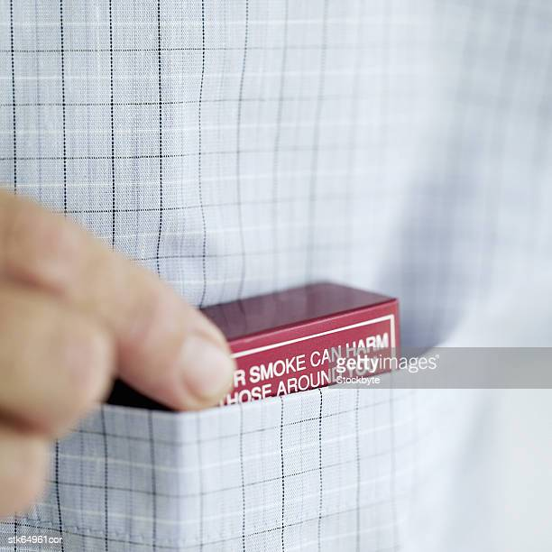 man with pack of cigarette in shirt pocket - cigarette pack stock pictures, royalty-free photos & images