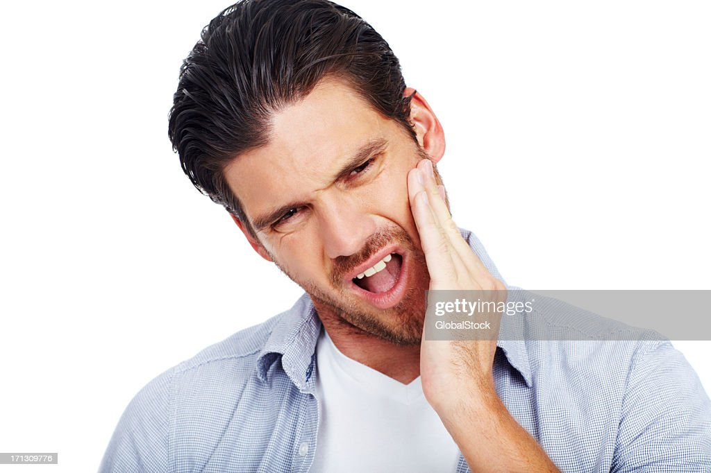 Man with painful expression holding one cheek : Stock Photo