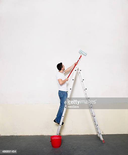 Man with paint roller renovating