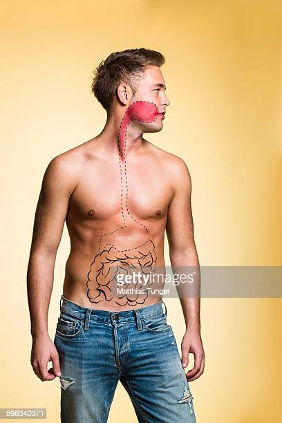 Man with painted organs on his body