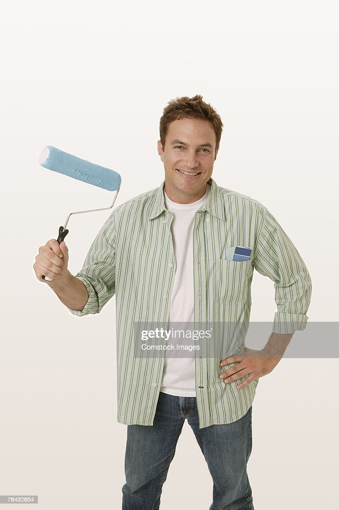 Man with painting supplies : Stockfoto
