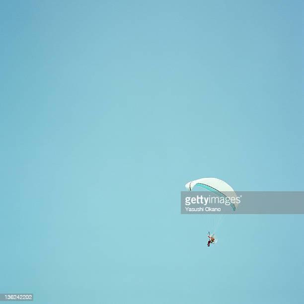 Man with parachute in air