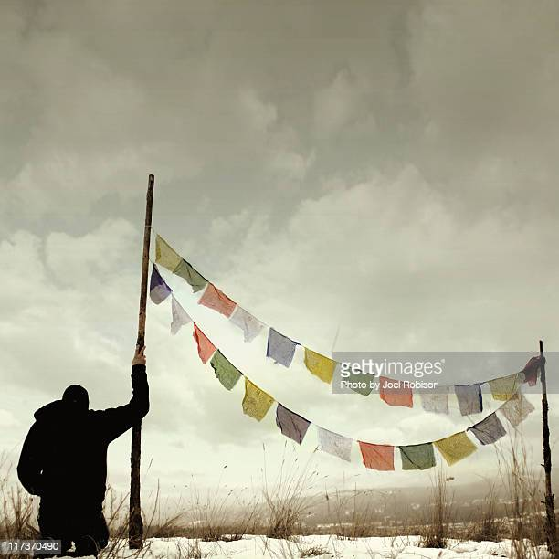 Man with payer flags