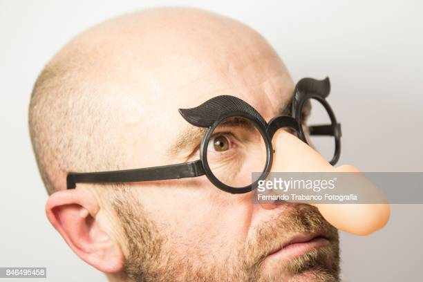 man with penis shape glasses - ugly bald man stock photos and pictures