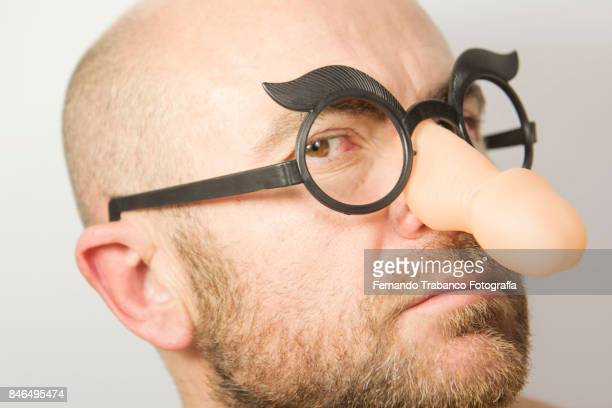 man with penis shape glasses - big nose stock photos and pictures