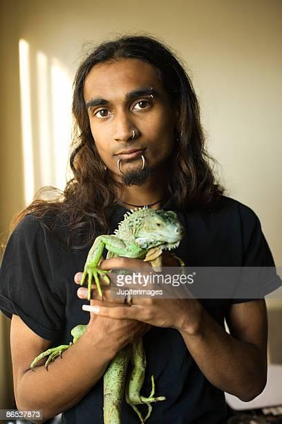 Man with pet iguana