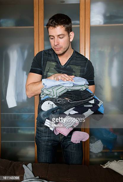 Man with pile of laundry