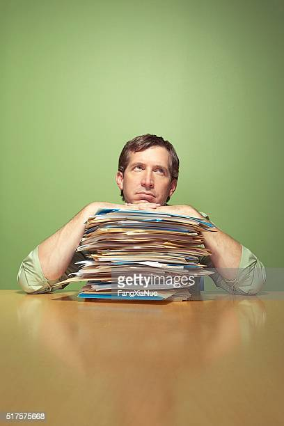 man with piles of work - wasting time stock pictures, royalty-free photos & images