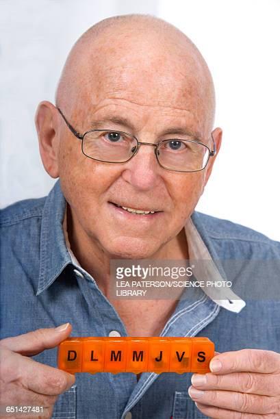 Man with pill organiser