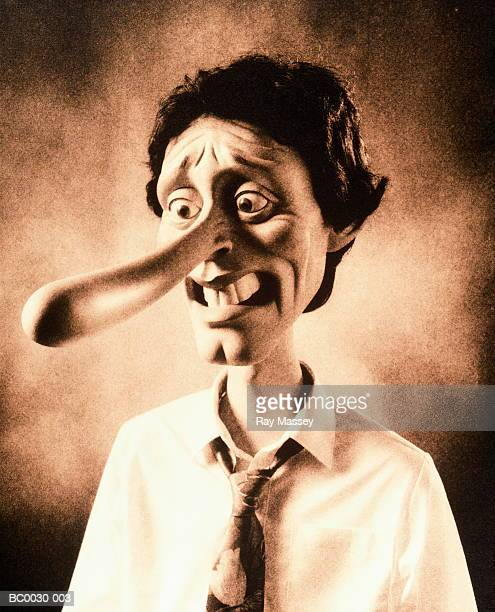 man with 'pinocchio'-style nose (toned b&w) - long nose stock photos and pictures
