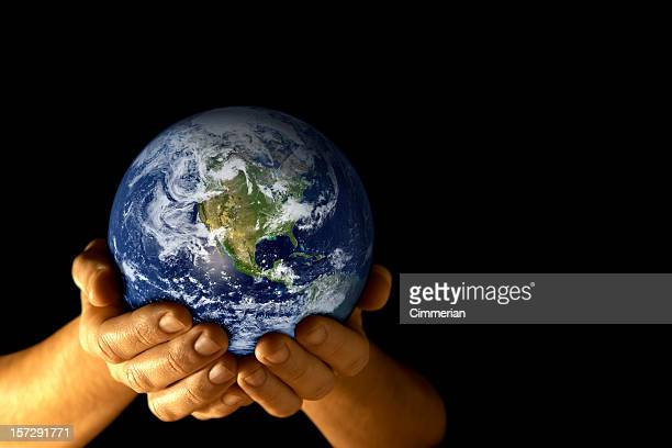 man with planet earth in hands - world map stock photos and pictures