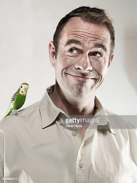 Man with plastic budgerigar