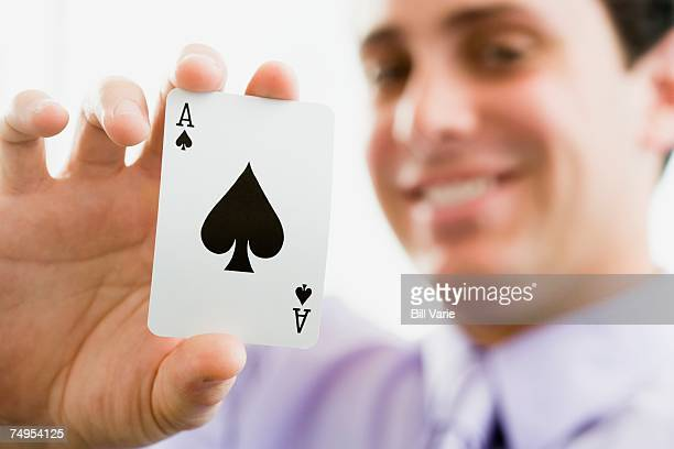 Man with playing card