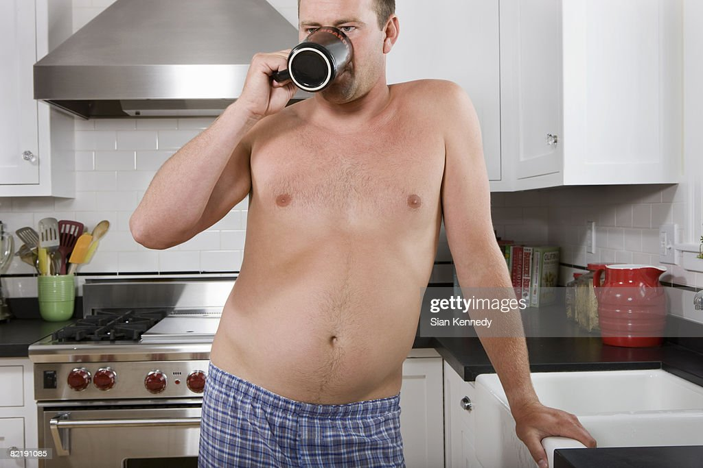 Man with pot belly drinking coffee : Stock Photo