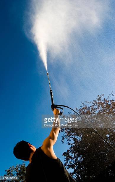 Man with pressure washer