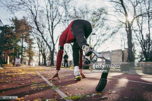 man with prosthetic leg on running outdoors - fake man stock photos and pictures