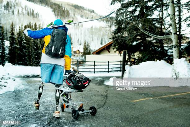 Man with prosthetics and wheelchair sled.