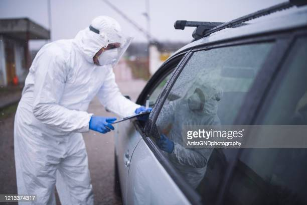 man with protective suit at border controlling - pandemic illness stock pictures, royalty-free photos & images