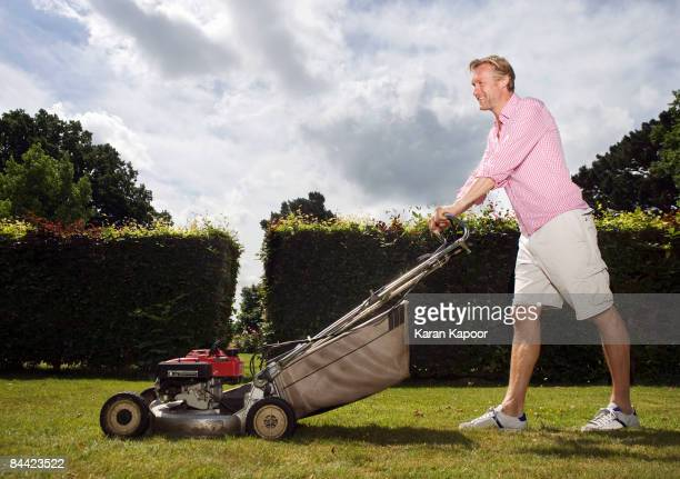 man with push lawnmower - lawn stock pictures, royalty-free photos & images