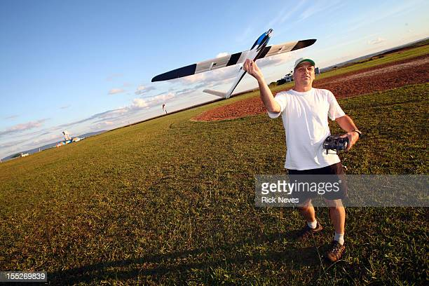 Man with radio control airplane