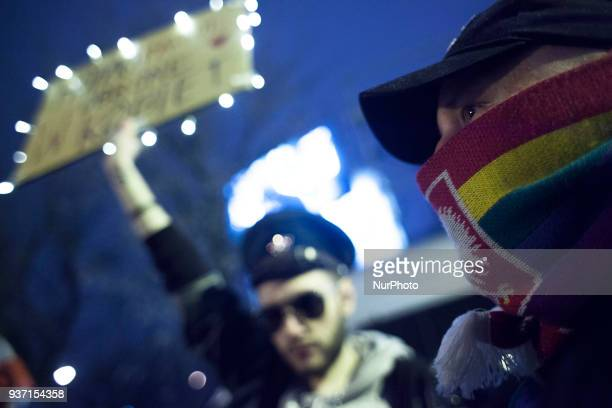 A man with rainbowaltered Polish emblem on his scarf during strike against restrictions in Abortion Law in Warsaw on March 23 2018