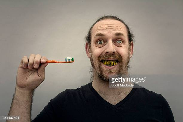 man with really bad teeth - bad teeth stock photos and pictures