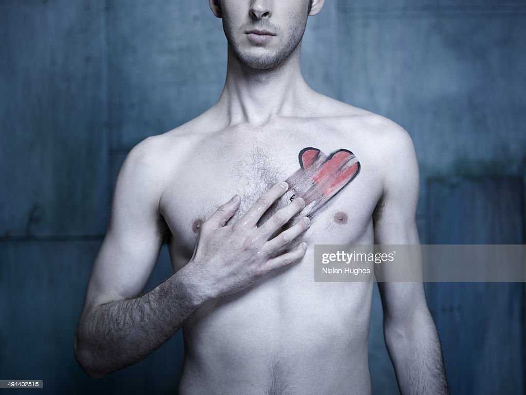 Man with red heart smeared across his chest : Stock Photo